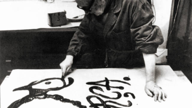 Photo of Joan Miró painting the poster for FC Barcelona's 75th anniversary