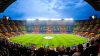 panoramic view of camp nou with the motto in catalan thank you team