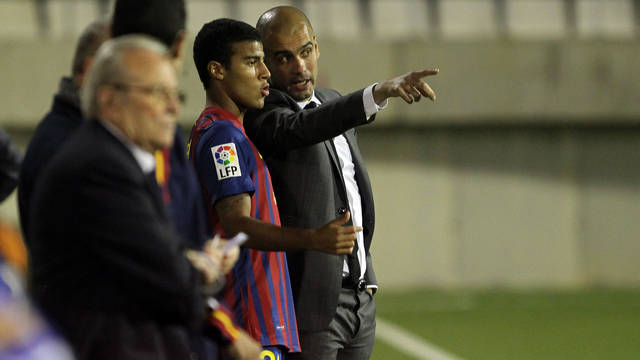 Rafinha with Guardiola. PHOTO: MIGUEL RUIZ (FCB).
