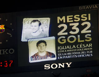 the stadium scoreboard announces how Messi had equalled Cesar's goalscoring record for barcelona