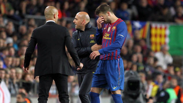Piqué after the collision / PHOTO: MIGUEL RUIZ-FCB