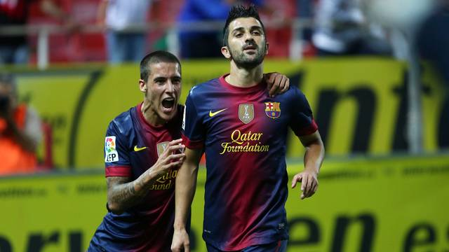Tello and Villa celebrate the match-winning goal / PHOTO: MIGUEL RUIZ-FCB