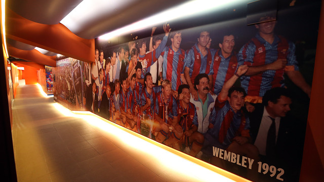 Changing room areas with a big picture in the wall of the Champions League at Wembley 1992