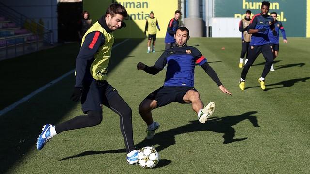 Piqué and Mascherano / PHOTO: MIGUEL RUIZ - FCB