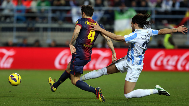 Cesc vs Málaga. PHOTO: MIGUEL RUIZ-FCB.