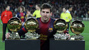 Messi with his four Ballons d'Or. PHOTO: MIGUEL RUIZ-FCB.