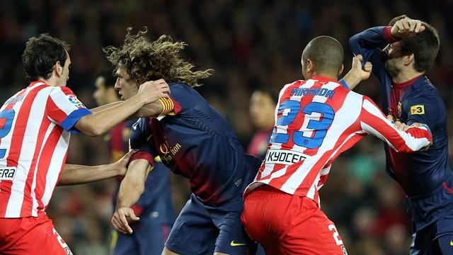 Puyol and Piqué against Atlético at the Camp Nou / Photo: Miguel Ruiz - FCB