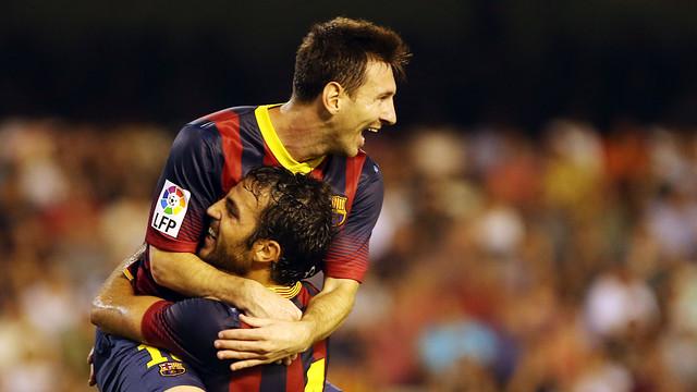 Messi, celebrating a goal with Fàbregas. PHOTO: MIGUEL RUIZ - FCB