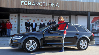 Carles Puyol getting into one of the new Audis handed over to the FC Barcelona players