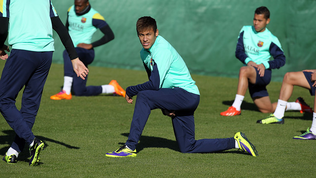 Neymar doing stretching exercises on the training ground pitch