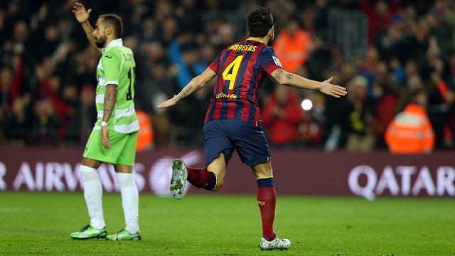 Cesc Fàbregas celebrates a goal against Getafe