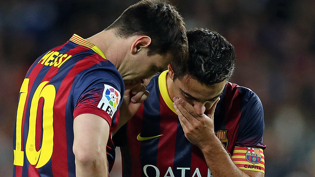 Messi and Xavi speaking during a match. PHOTO: MIGUEL RUIZ-FCB