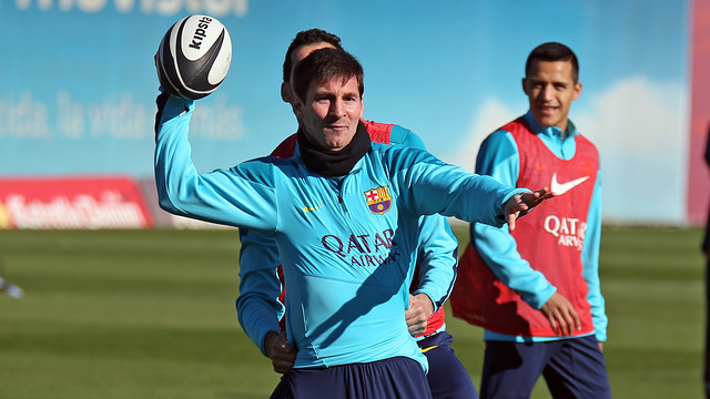 Messi had a go at American football this morning. PHOTO: MIGUEL RUIZ-FCB.