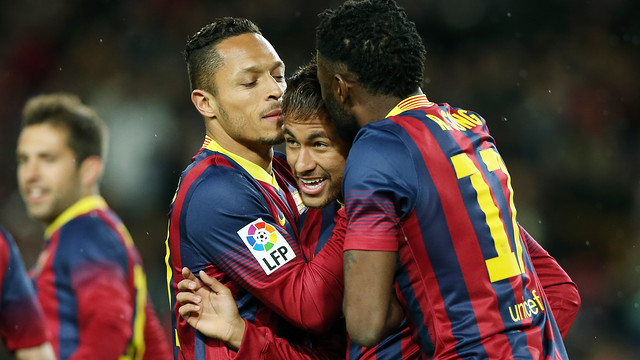 Neymar celebrates his goal against Celta with Adriano and Song
