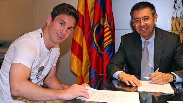 Messi y Josep Maria Bartomeu