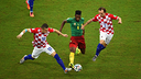Ivan Rakitic and Alex Song fight for possession / PHOTO: fifa.com