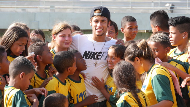 Some children hug Neymar at the Instituto facilities.