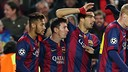 Neymar, Messi e Suárez celebram um gol contra o PSG.