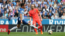 Andrés Iniesta beats Espanyol's Lucas with a pass in Barça's 2–0 victory on Saturday.  / MIGUEL RUIZ-FCB