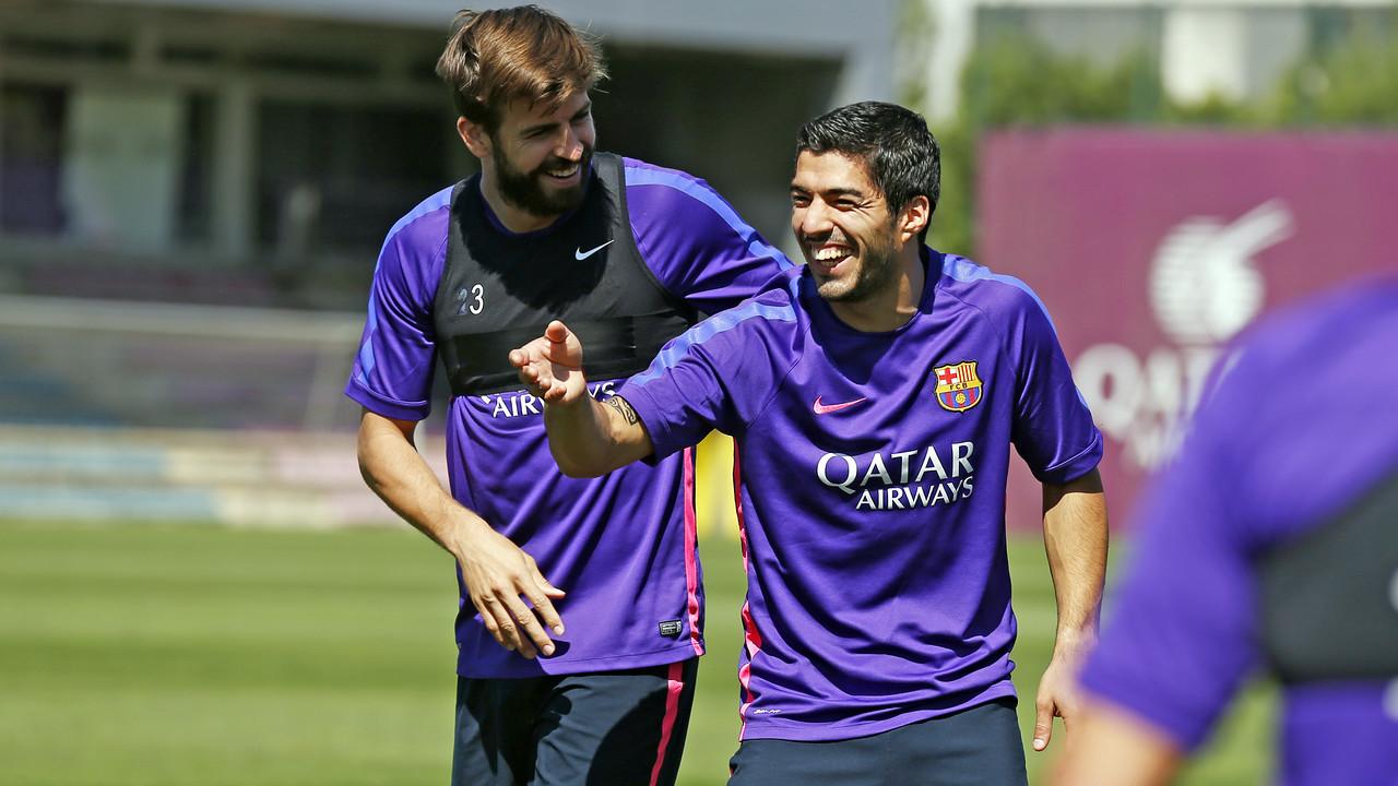 Piqué i Suárez, a l'entrenament d'aquest dimecres / MIGUEL RUIZ-FCB