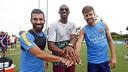 Arda Turan and Gerard Piqué pose with Kobe Bryant in Los Angeles. / MIGUEL RUIZ-FCB