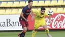 Juan Antonio Ros of Barça B takes on Carlos Martínez / VILLARREAL CF