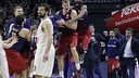 Justin Doellman is mobbed by his teammates after his buzzer-beater gave FC Barcelona an 87–86 victory over Real Madrid on Thursday night. / EUROLEAGUE