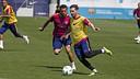 Leo Messi et Dani Alves durant pendant un entrainement / MIGUEL RUIZ - FCB